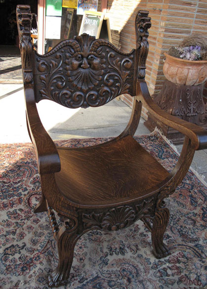 North wind and lion oak throne chair